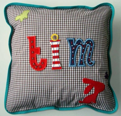 Make name cushions with iron-on letters.