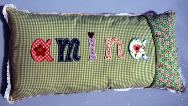 I use iron-on letters to iron on names on name cushions that decorate nurseries.