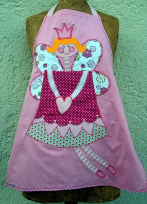 Child name on a name apron is a personalized name gift for a child.