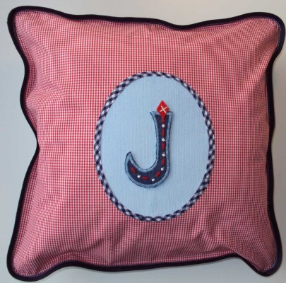 Decorate toddler cushions with iron-on letters.